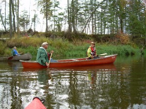 Jerry and Iona in a red canoe